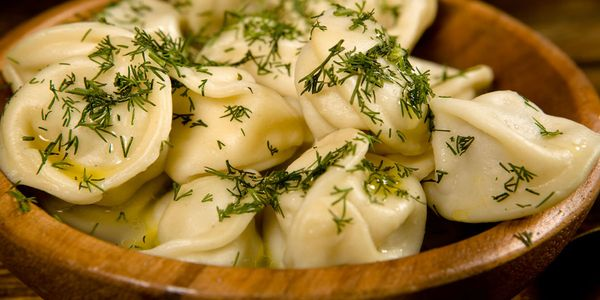 Pelmeni with dill, image found at https://nutritek.ru/general-questions/what-kind-of-dough-makes-dumplings-recipes-for-dumplings-from-classic-to-custard.html